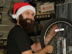 Santa bike mechanic