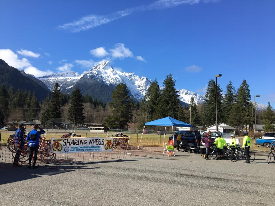 bicycle racks and fencing with mountain in background