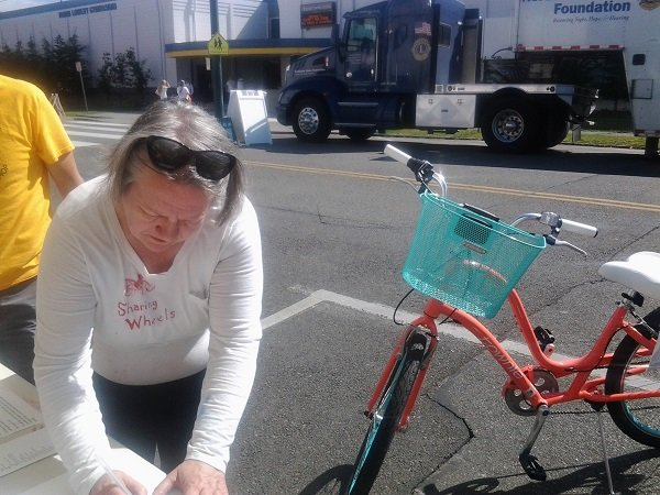 Woman signs in a bicycle